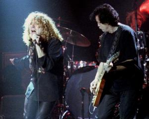 Led Zeppelin singer Robert Plant and guitarist Jimmy Page at a 1998 concert. Photo: Reuters