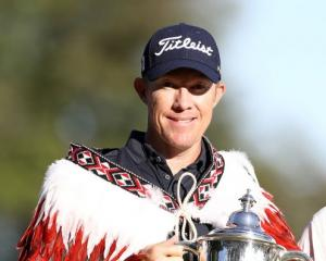Australian golfer Brad Kennedy wears acloak presented to him after winning the 2020 New Zealand...