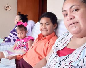 Reading from the Bible are the Vai family (from left) Lute, Akolotu, Tevita and Lea Vai. PHOTO:...