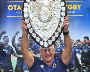 Otago Rugby Football Union community rugby manager Richard Perkins holds the Ranfurly Shield...