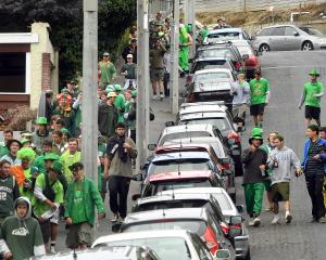 Dunedin students make their way down Park St towards a flat party in Queen St to celebrate St...