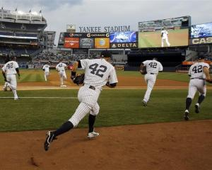 The New York Yankees take the field before their MLB Interleague game against the Arizona...