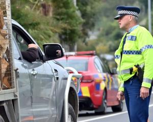 Police were stopping vehicles driving in and out of Mosgiel today to ensure people were complying...