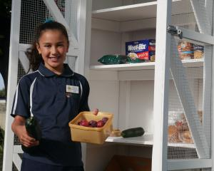 Elmgrove School pupil and ambassador Leah Boyce (10) holds some fruit and vegetables that have...