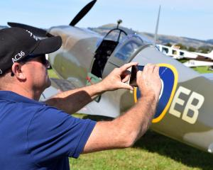 Ray van der Vliet, of Mosgiel, photographs a replica British Supermarine Spitfire MK 26 at the...