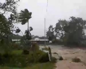 Cyclone Harold brings strong winds in Luganville, Vanuatu, in this still obtained from a social...