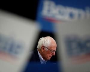 "Bernie Sanders says it was a ""difficult and painful decision"" to end his run for president. Photo..."
