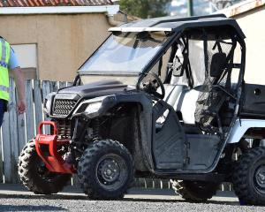 Police inspect the ATV yesterday. Photo: Peter McIntosh
