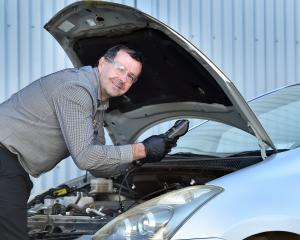 AA Auto Centre Dunedin service manager Shaun Fairbairn checks a car battery to make sure it is...