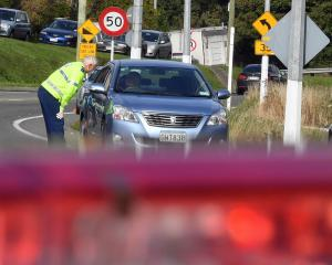Leaving town? At a checkpoint near Pine Hill on Thursday, police stop cars to ensure their...