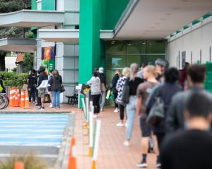 People queuing to get into a Countdown supermarket during the Covid-19 lockdown. Photo: RNZ