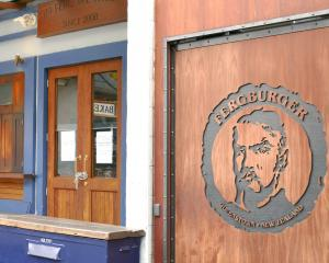Queenstown's Fergburger and Blue Kanu (below) restaurants sit empty during the Covid-19 lockdown....