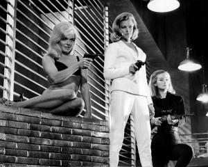 Bond girl Honor Blackman (centre) played Pussy Galore in Goldfinger. Photo: Getty Images