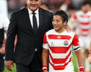 Japan coach Jamie Joseph with halfback Yutaka Nagare after the side played South Africa in the...