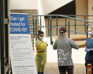 A patient arrives at a pop-up testing clinic next to Bondi Beach in Sydney. Photo: Getty Images