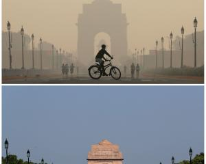 New Delhi's India Gate war memorial in 2019 (above) and after the air pollution level started to...