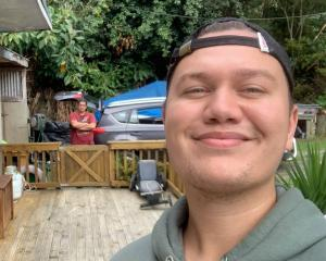 Josh Dent back home in the Bay of Islands as his father, Sam Dent, watches on while living in his...