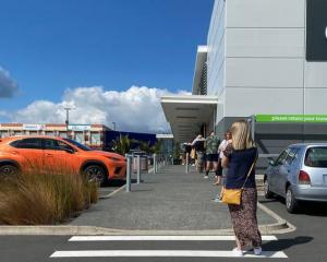 Long lines outside supermarkets have been common during lockdown. Photo: Cole Slawson