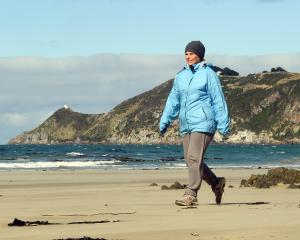 Clutha youth worker Margaret Cardno de-stresses on the beach near Nugget Point, in the Catlins....