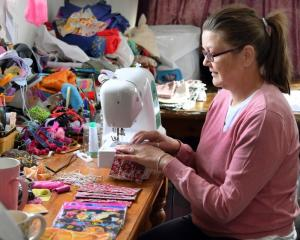 Sewing up a storm ... Dunedin grandmother Michelle Webb has made more than 350 masks for the...