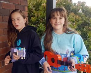 Twins (from left) Darcy and Tegen Baldwin (12) stick together while singing Dave Dobbyn's Slice...