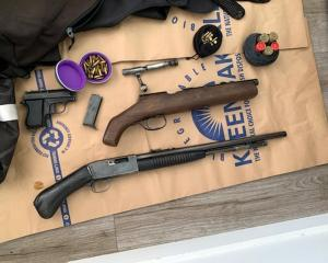 Police recovered weapons and drugs in two linked raids in Queenstown and Christchurch. PHOTO:...