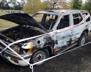 What is left of the burnt out Nissan Terrano Regulus on Shands Rd, Prebbleton. Photo: Geoff Sloan