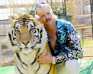 Joe Exotic, the eponymous Tiger King and one of his rugs in waiting. Photo: Supplied