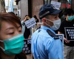 Activists march against new security laws, near China's Liaison Office, in Hong Kong. Photo: Reuters