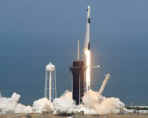 The SpaceX Falcon 9 rocket and Crew Dragon spacecraft lifts off from NASA's Kennedy Space Center...