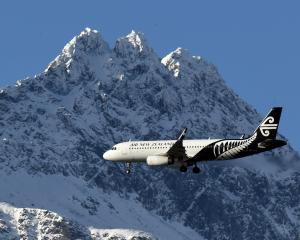 An Air New Zealand Airbus A320 passes the Remarkables, headed to Queenstown Airport. PHOTO:...