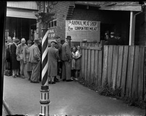 A queue at The Animal Meat Shop in the 1940s in Dunedin, thought to be on the north side of...