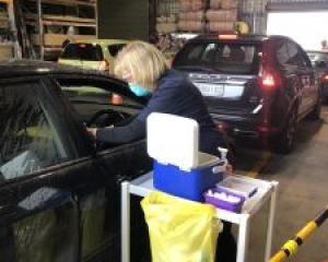 Staff meet patients during a drive-through flu vaccination clinic at Ashburton ITM. Photo: Supplied