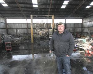 Mr Goatley stands inside the shell of the burnt-out workshop.PHOTOS: JOHN COSGROVE