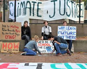 Climate activists (from left) Sophie Davison (16), Ja Thea (15), Dante Dawes (16), Hugo Calder ...