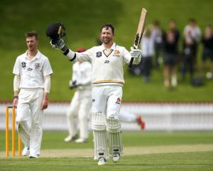 Devon Conway celebrates his triple century for Wellington against Canterbury yesterday. Photo:...