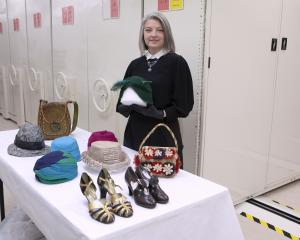 Dr Jill Haley with some of the hats, bags and shoes from the Mollie Rodie Mackenzie Collection....