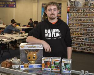 Dice Jar Games owner Greg Mansfield in  his new store at an upstairs space on George St. PHOTO:...