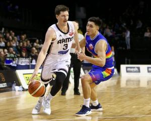 Cameron Gliddon of the Rams attempts to evade Reuben Te Rangi of the Saints last year. Photo:...