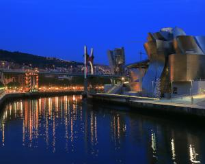 Night view of Guggenheim Museum with Nervion River in foreground. Photos: Getty Images.