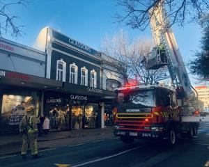 A ladder truck operates on George St this morning after a false alarm. Photo: Craig Baxter
