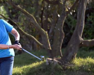 Allison Mulder, of Dunedin, plays a shot at Chisholm Links earlier this week. PHOTO: PETER MCINTOSH