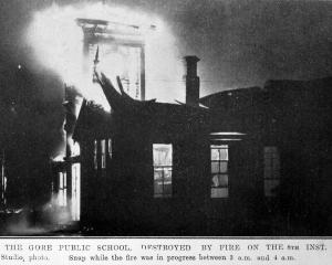 The Gore public school, destroyed by fire on May 8, while the fire was in progress between 3am...