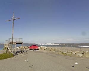 Police say the girl was whitebaiting with an elderly man at the Hokitika River mouth. Image: Google