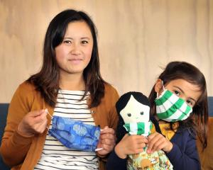 Dr Ling Chan, a pathology doctor in Dunedin, and her daughter, Isla Ansell (6), holding her doll...