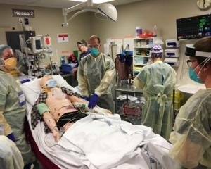 Emergency services and Dunedin Hospital staff test their processes during recent Covid-19...