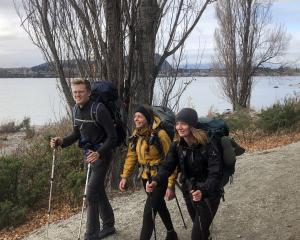Te Araroa Trail trampers Lukas Waser (21), of Switzerland, and Alexandra Hog (28, centre) and...