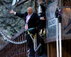 Queenstown Lakes Mayor Jim Boult prepares for a dawn jump from AJ Hackett Bungy's Kawarau Bridge...