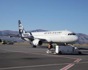 NZ1209 settles on the tarmac from Auckland. Photos: Hugh Collins