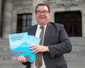 Finance Minister Grant Robertson with copies of this year's Budget. Photo: Getty Images